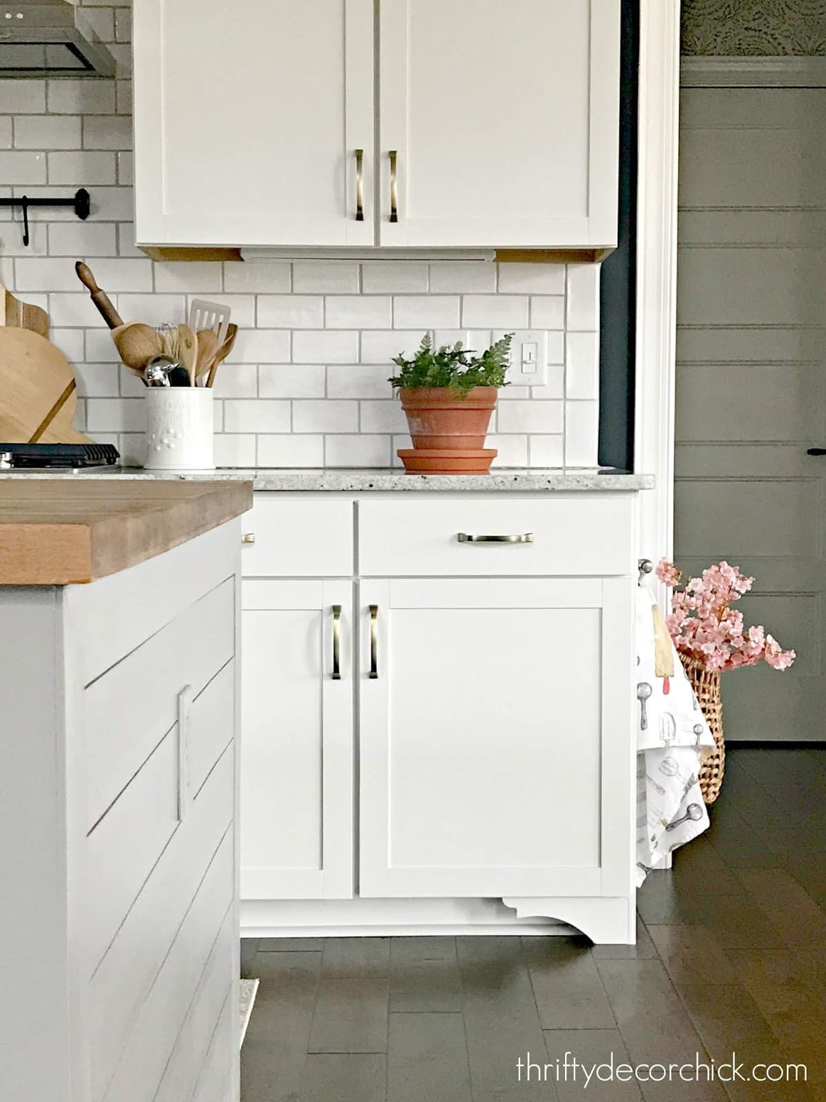 Adding feet to kitchen base cabinets elevates the look of stock cabinets