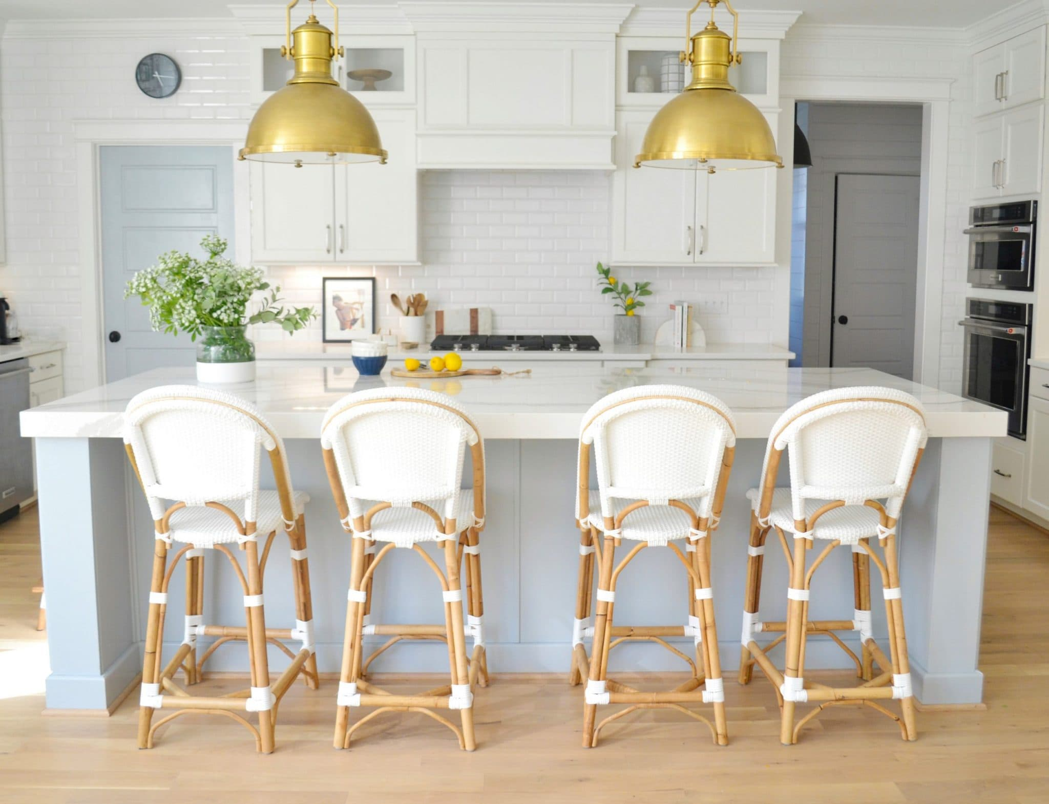 Sherwin Williams Krypton is the perfect light blue gray color for a kitchen island and pantry door