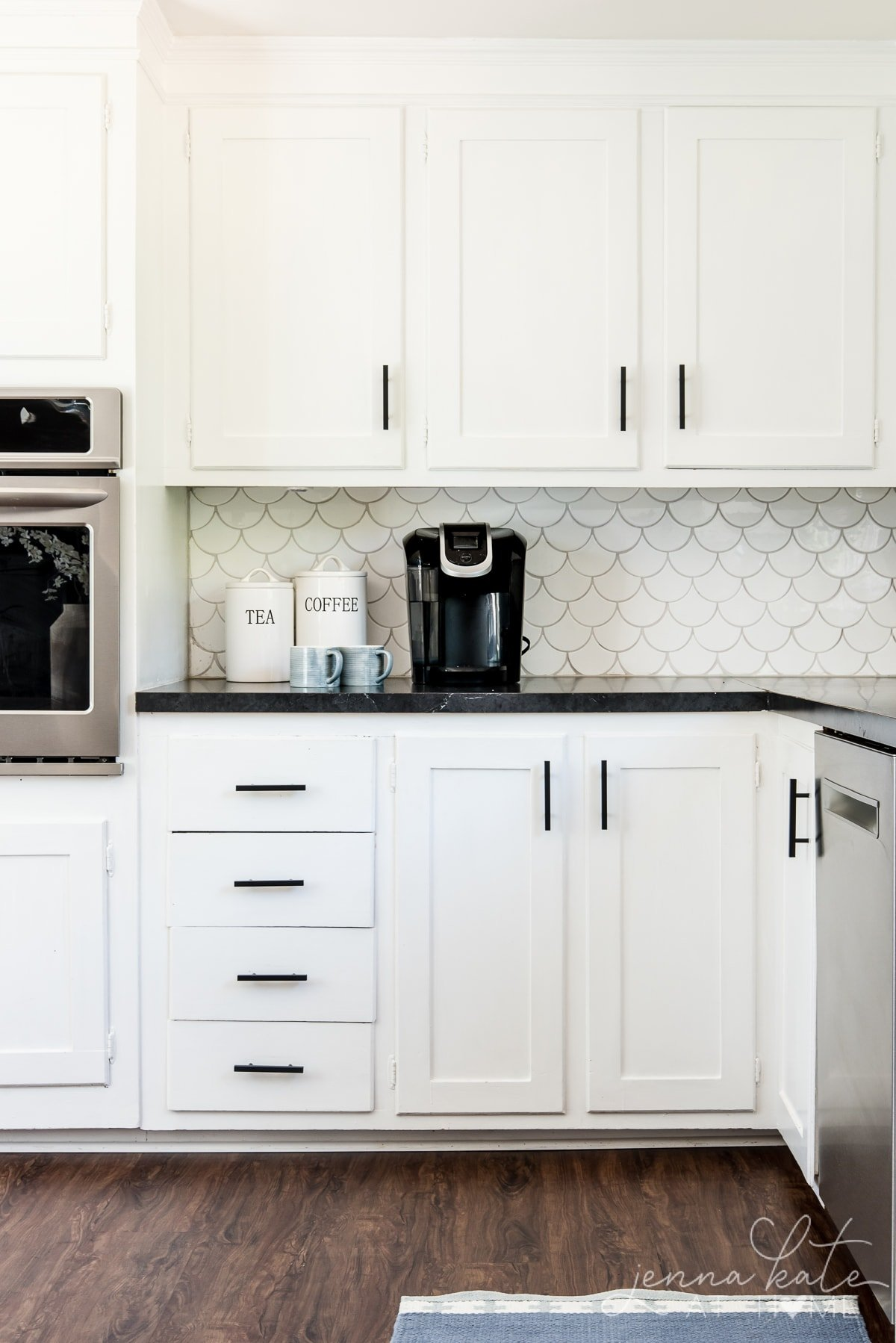 Matte black kitchen pulls are an inexpensive upgrade