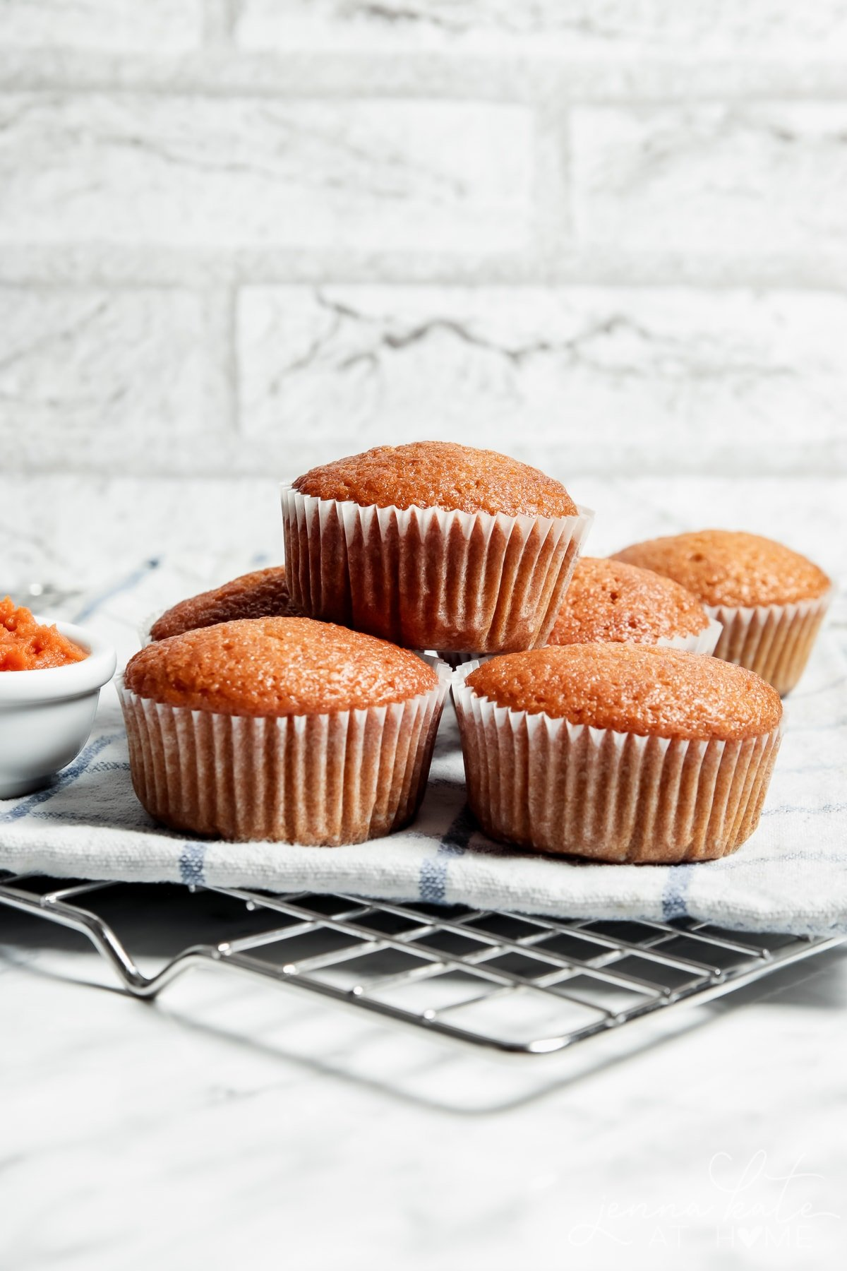 pumkin bread muffins stacked on a plate