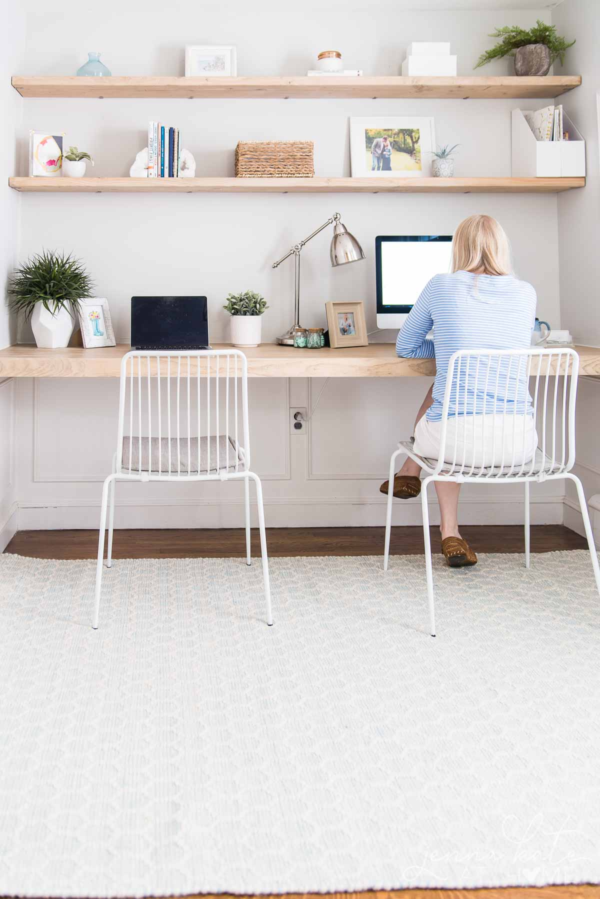 home office space with author working at a computer