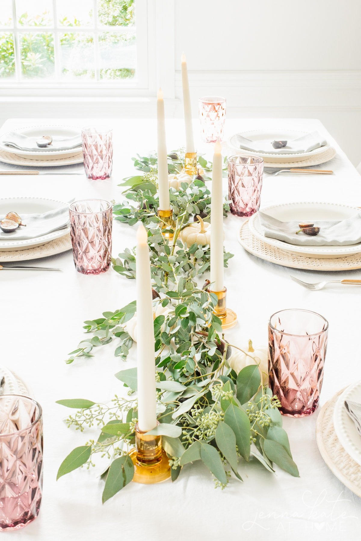 fall themed tablescape with eucalyptus draped down the center of the table