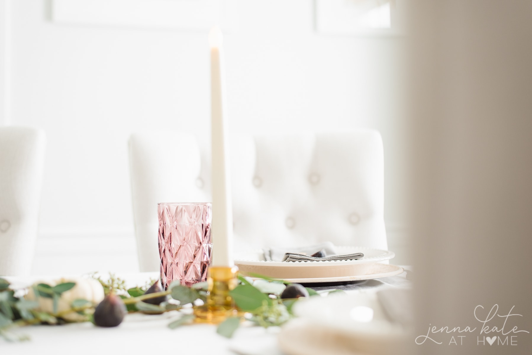 Plum colored glassware and amber glass tapered candle holders