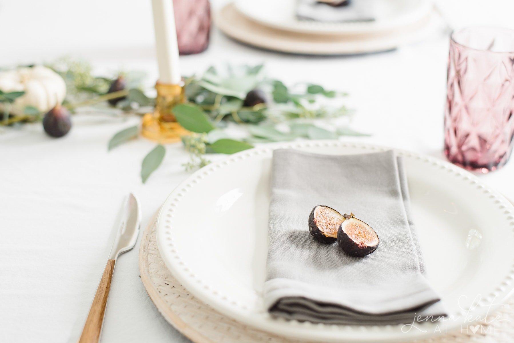 Cut fig and gray cloth napkin
