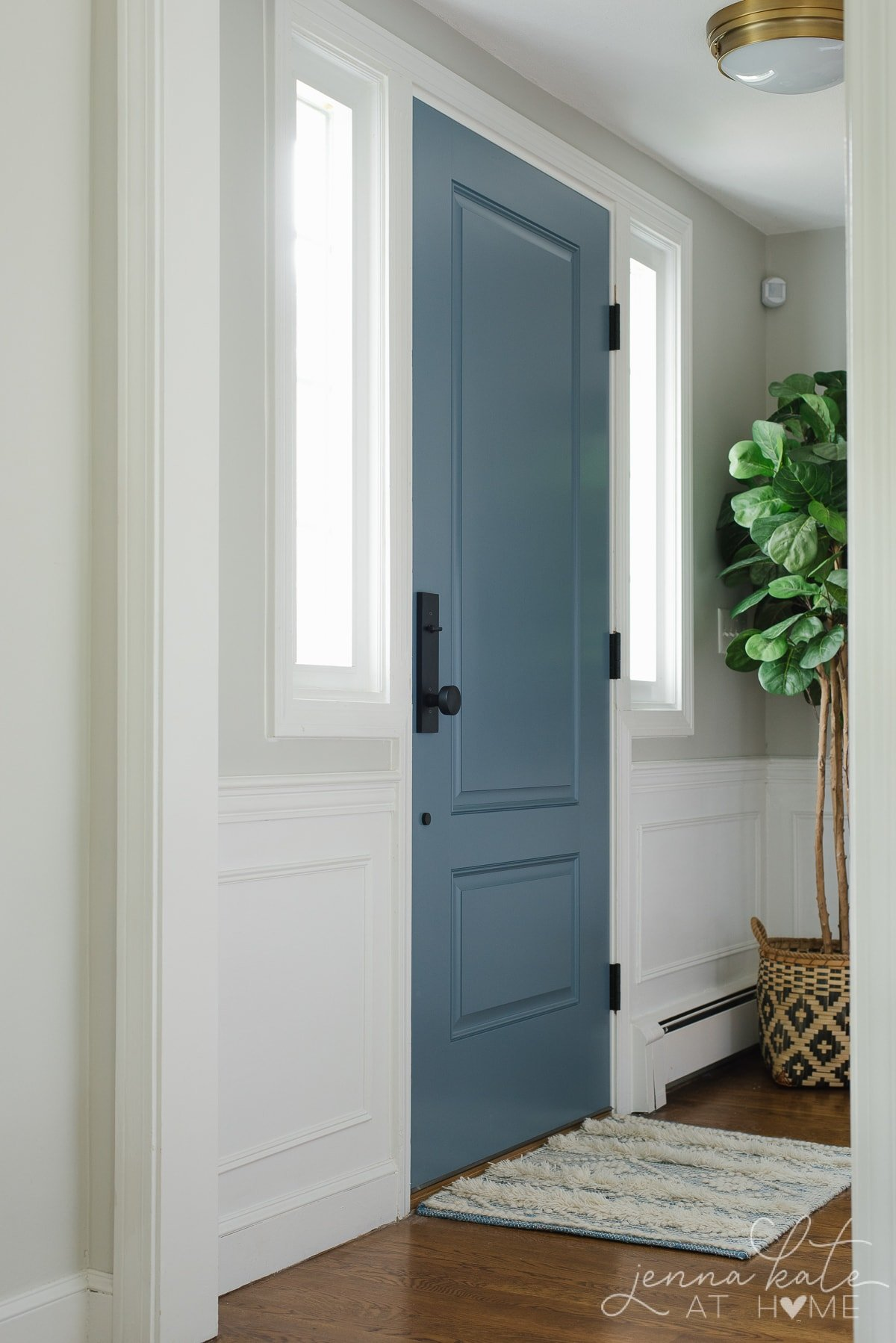 Interior trim, baseboards and wainscoting painted with Sherwin Williams Extra White