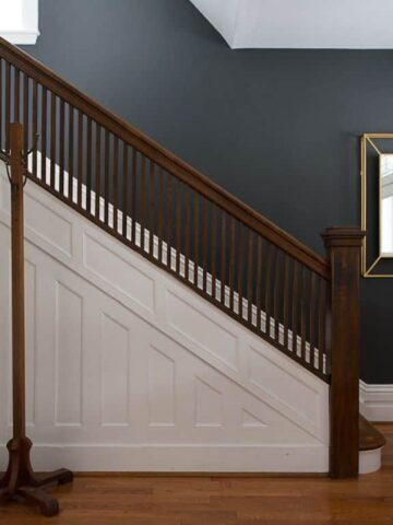 staircase with black accent wall