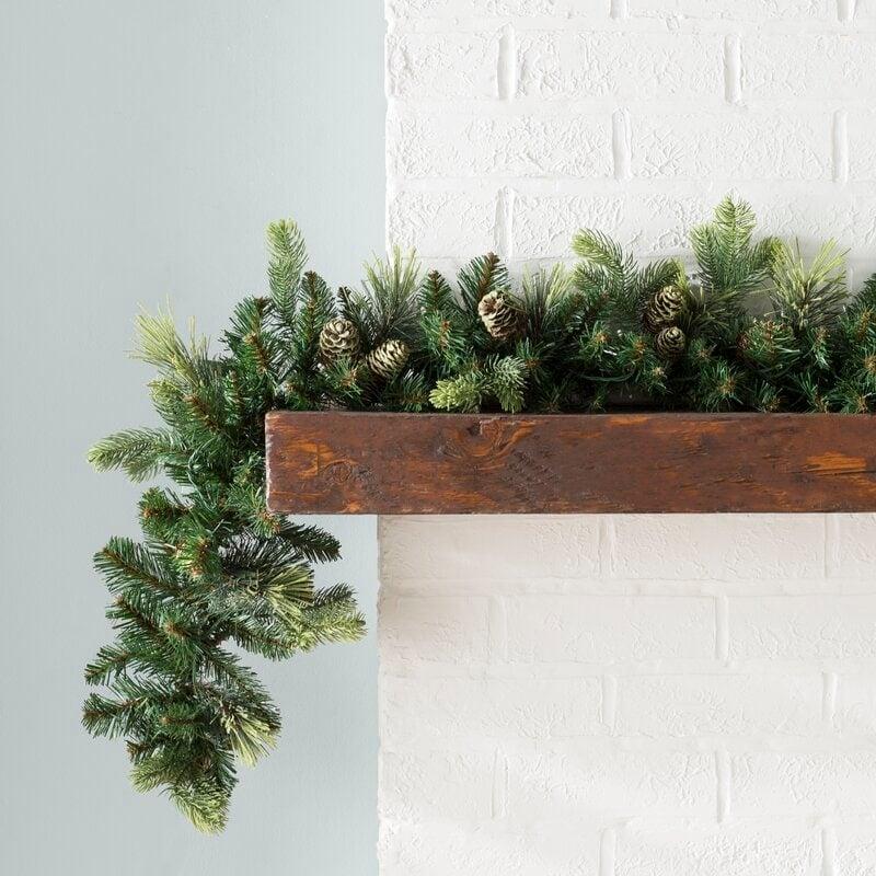 Pine garland on a wooden mantel