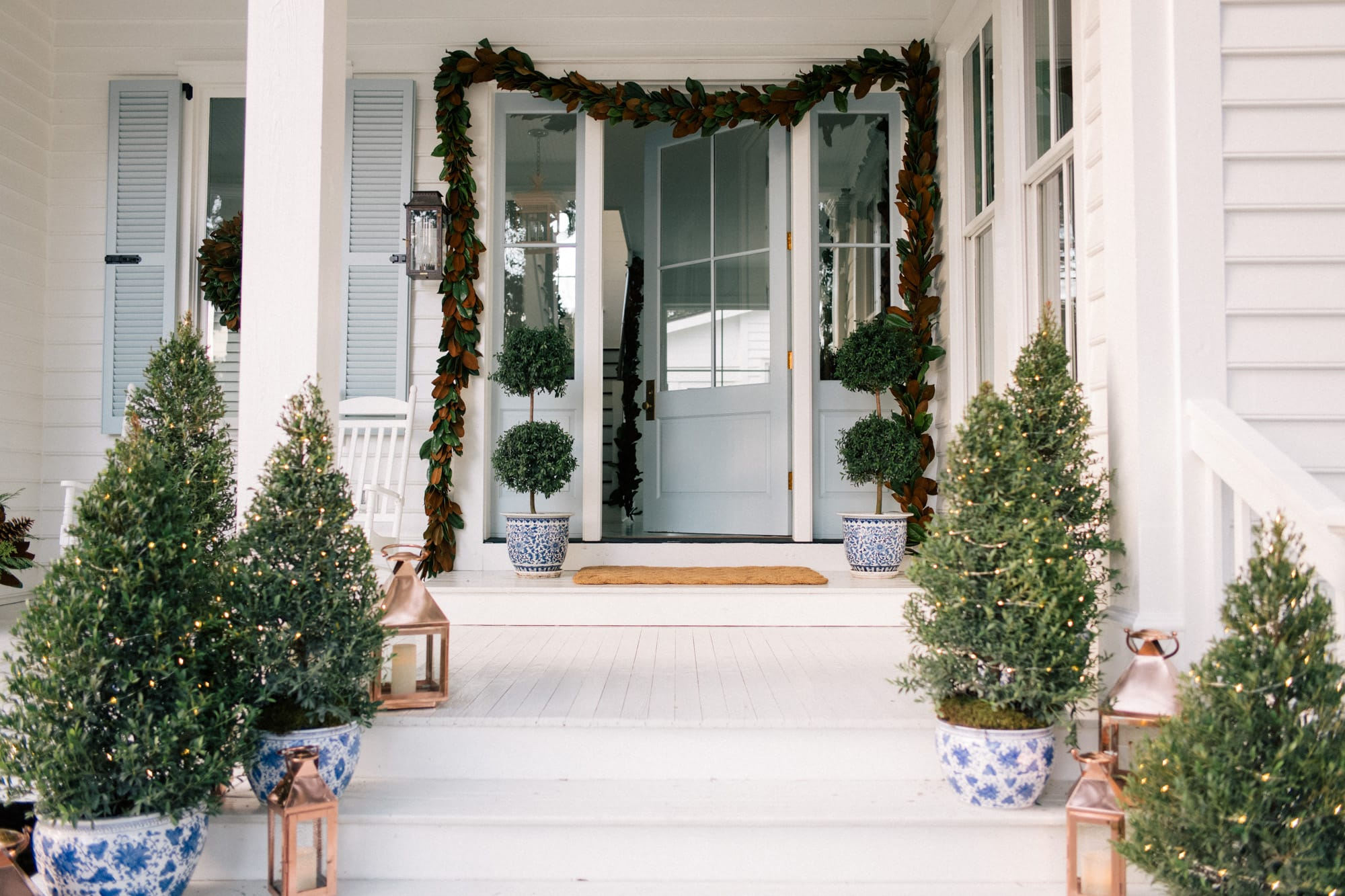 Really long real magnolia garland draped around a front door