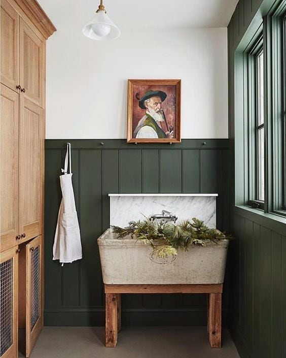 Wainscoting in laundry room painted Benjamin Moore Backwoods, a dark hunter green