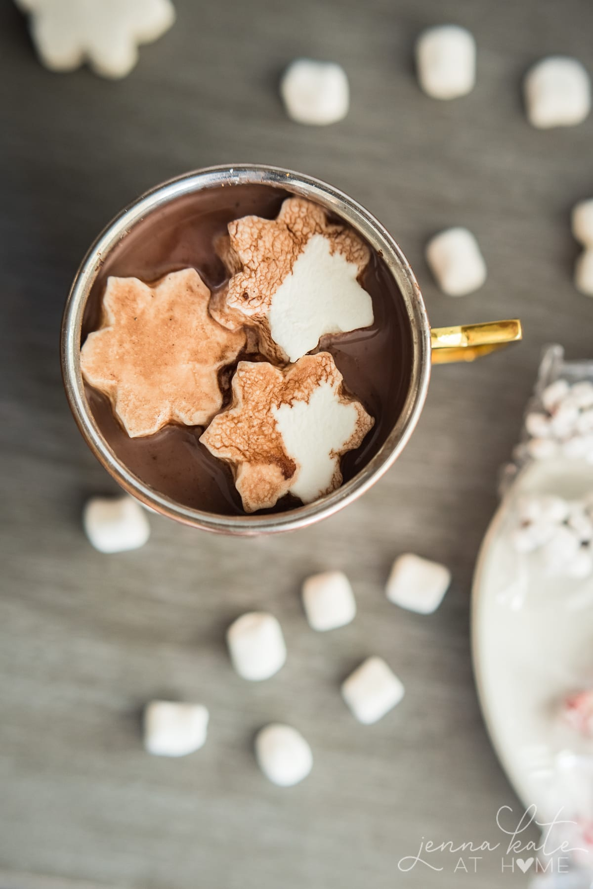 Snowflake marshmallows floating in a mug of hot chocolate