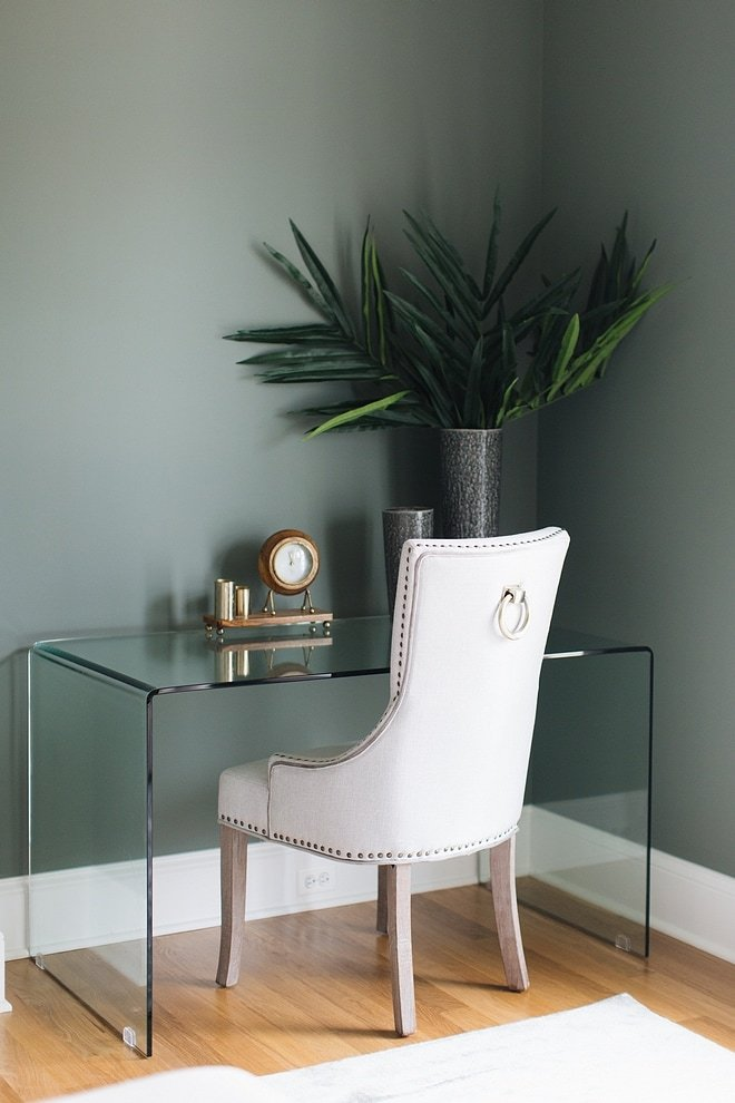 Sherwin Williams Retreat Green wall behind a desk