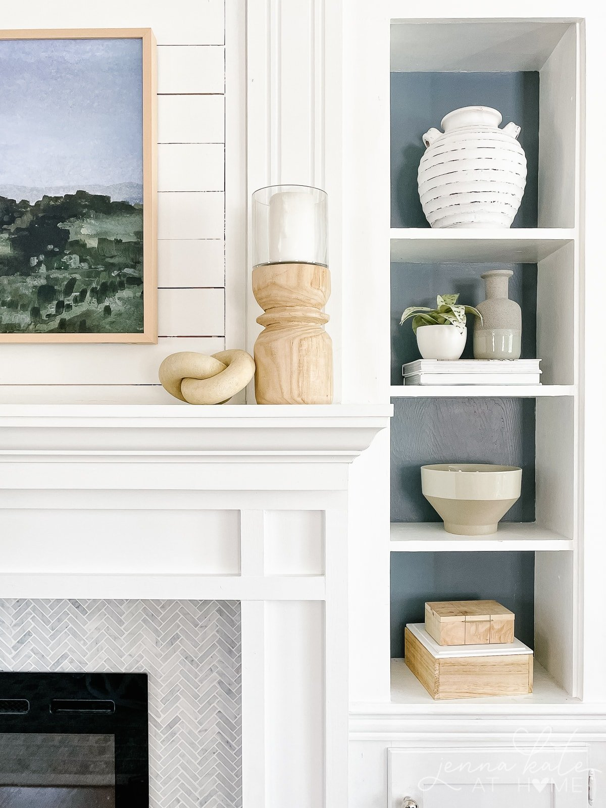 white mantel with natural wood candle holder
