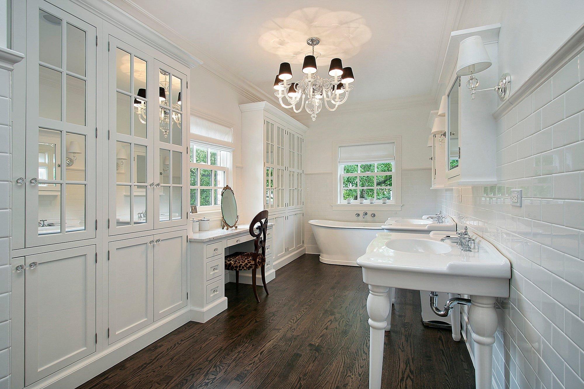 white bathroom with dark hardwood floors