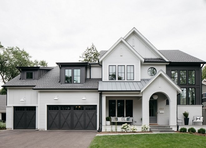 farmhouse style home with siding painted passive with black accents