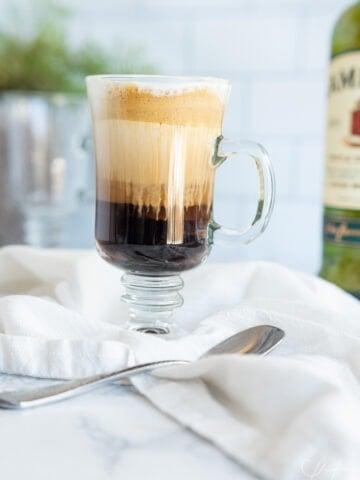 traditional Irish coffee in a glass coffee cup
