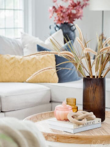 coffee table with amber vase and grass